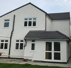 Thundersley House in SR15 Silicone Thin Coat Render - Rear